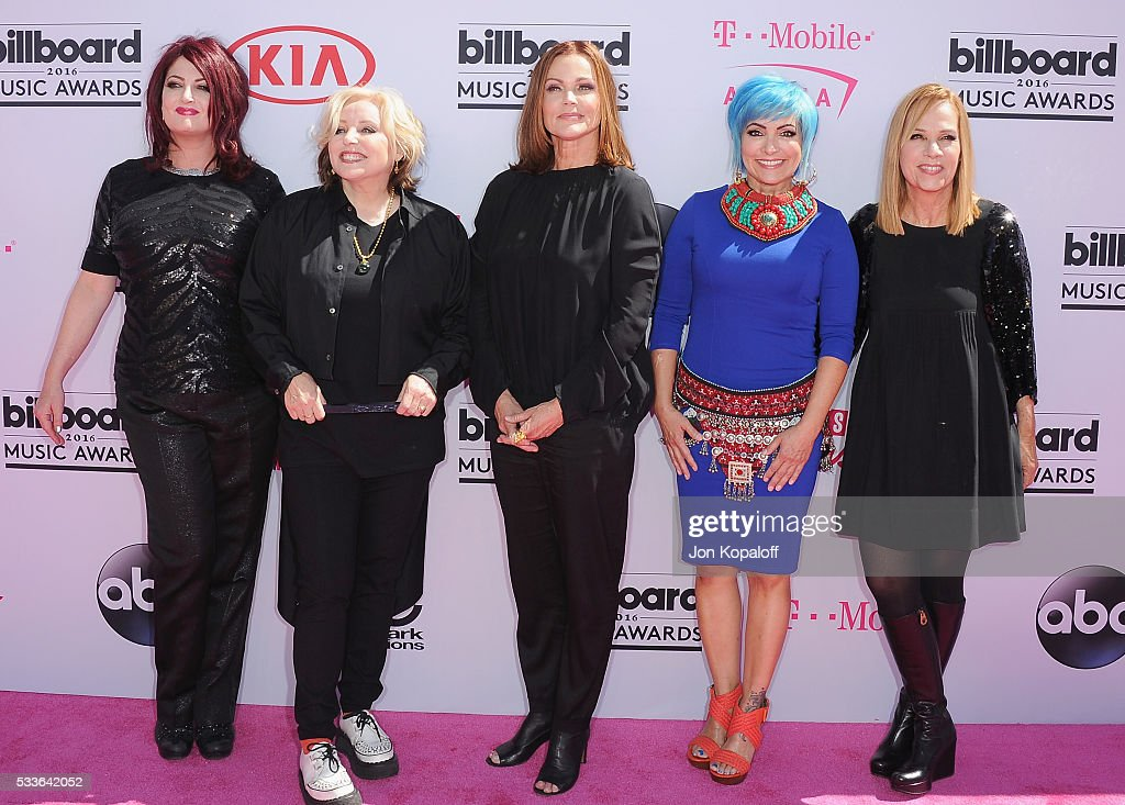 Recording artists Abby Travis Gina Schock Belinda Carlisle Jane Wiedlin and Charlotte Caffey of music group The GoGo's arrive at the 2016 Billboard...