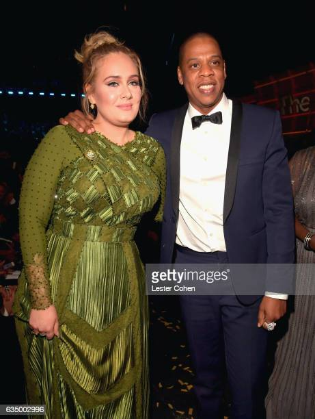 Recording artists Adele and Jay Z pose during The 59th GRAMMY Awards at STAPLES Center on February 12 2017 in Los Angeles California