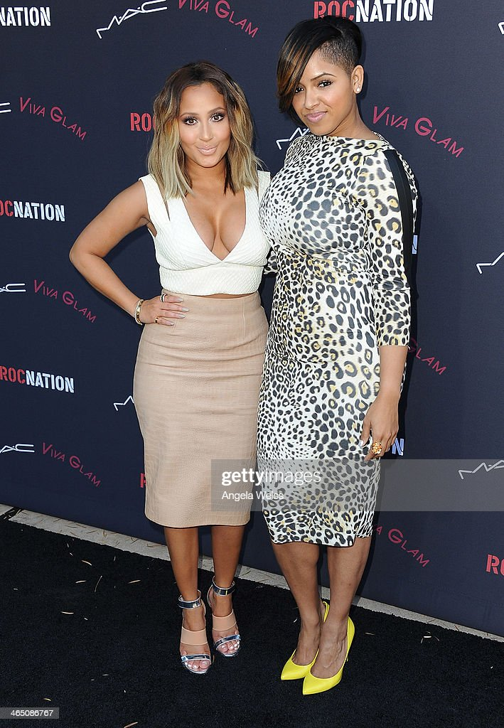 Recording artists Adrienne Bailon (L) and RaVaughn arrive at the Roc Nation Pre-Grammy brunch presented by MAC Viva Glam at a private residency on January 25, 2014 in Los Angeles, California.