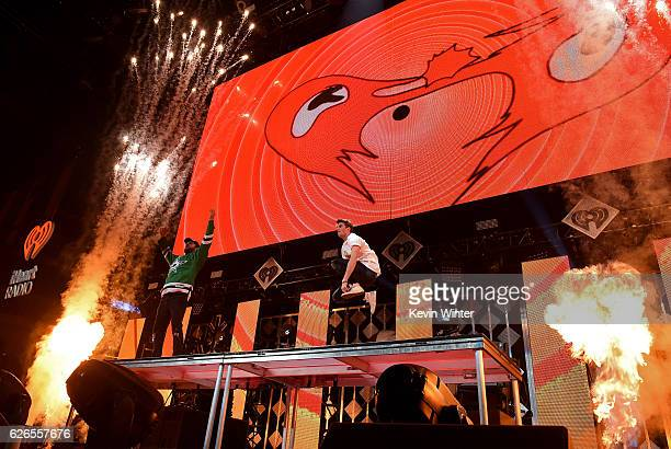 Recording artists Alex Pall and Andrew Taggart of music group The Chainsmokers perform onstage at 1061 KISS FM's Jingle Ball 2016 presented by...