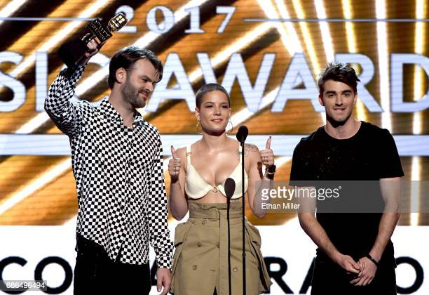 Recording artists Alex Pall of The Chainsmokers Halsey and Andrew Taggart of The Chainsmokers accept the Top Collaboration award for 'Closer' onstage...