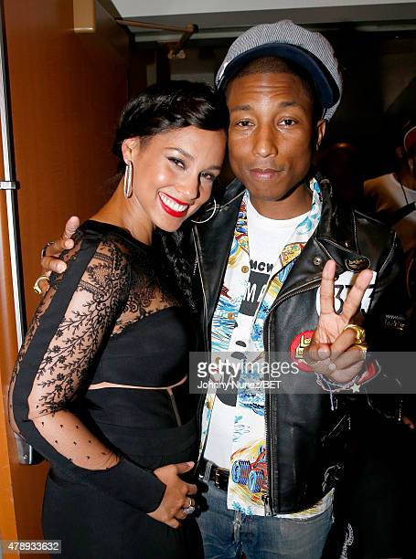 Recording artists Alicia Keys and Pharrell Williams pose backstage during the 2015 BET Awards at the Microsoft Theater on June 28 2015 in Los Angeles...