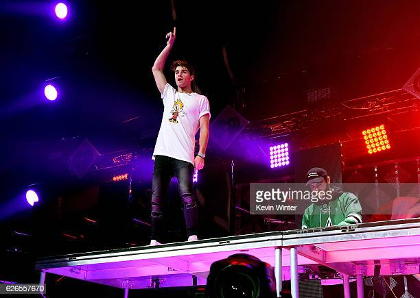 Recording artists Andrew Taggart and Alex Pall of music group The Chainsmokers perform onstage at 1061 KISS FM's Jingle Ball 2016 presented by...
