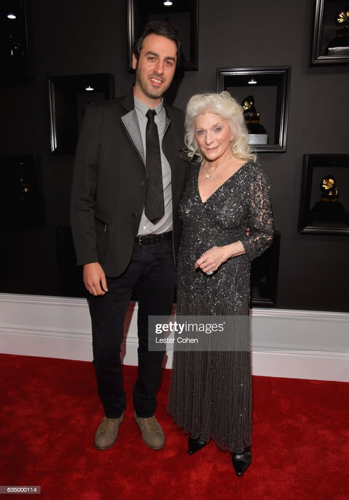 Recording artists Ari Hest (L) and Judy Collins attend The 59th GRAMMY Awards at STAPLES Center on February 12, 2017 in Los Angeles, California.