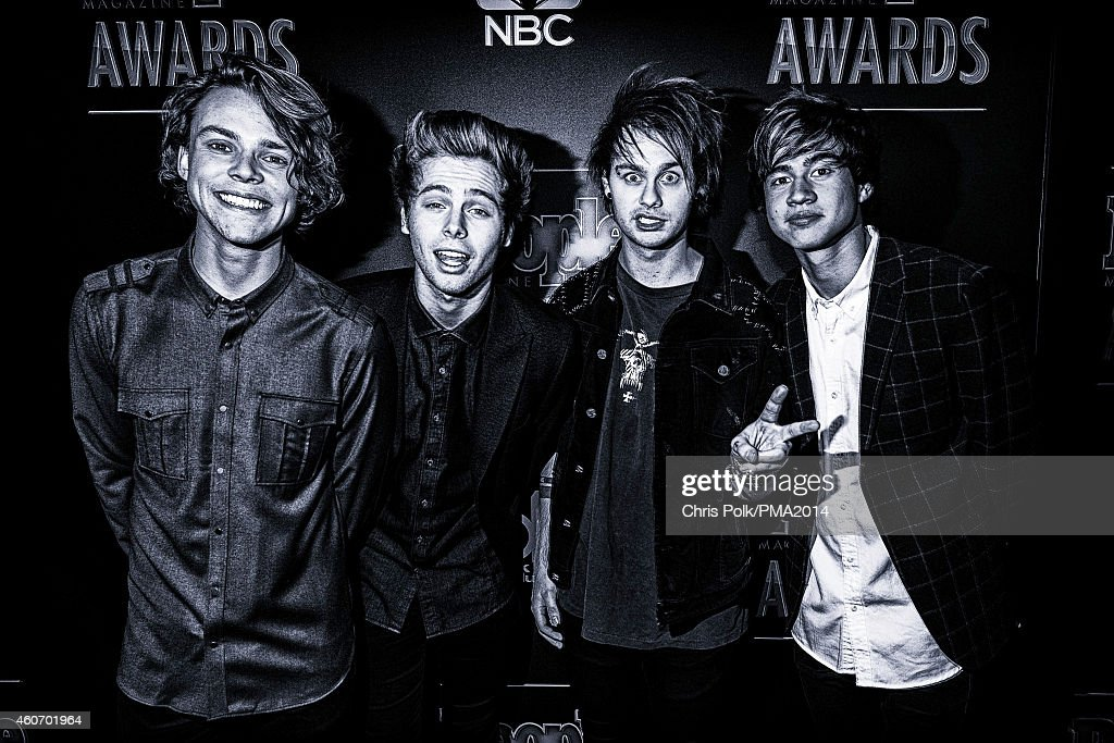 . L-R) Recording artists Ashton Irwin, Luke Hemmings, Michael Clifford and Calum Hood of music group 5 Seconds of Summer attend the PEOPLE Magazine Awards at The Beverly Hilton Hotel on December 18, 2014 in Beverly Hills, California.