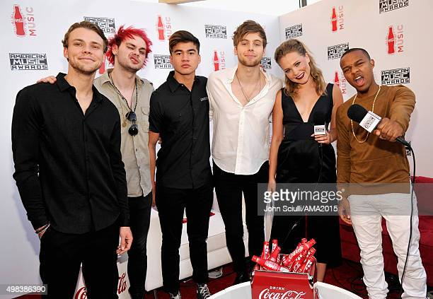 Recording artists Ashton Irwin Michael Clifford Calum Hood and Luke Hemmings of music group 5 Seconds Of Summer and TV personality Poppy Jamie and...