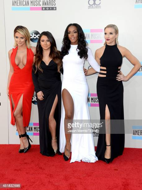 Recording artists Aubrey O'Day Andrea Fimbres Dawn Richards and Shannon Bex of music group Danity Kane attend the 2013 American Music Awards at Nokia...