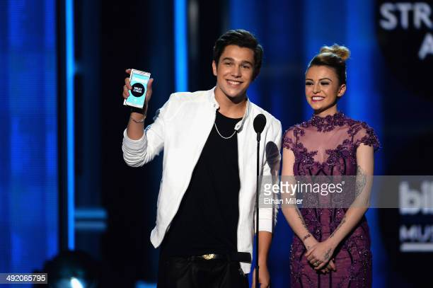 Recording artists Austin Mahone and Cher Lloyd speak onstage during the 2014 Billboard Music Awards at the MGM Grand Garden Arena on May 18 2014 in...
