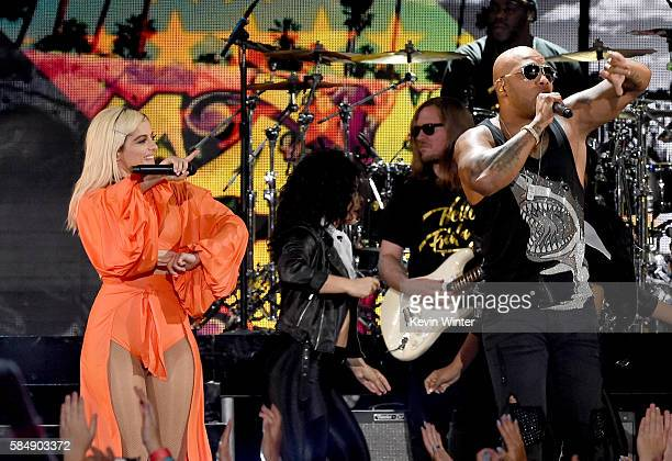 Recording artists Bebe Rexha and Flo Rida perform onstage during Teen Choice Awards 2016 at The Forum on July 31 2016 in Inglewood California