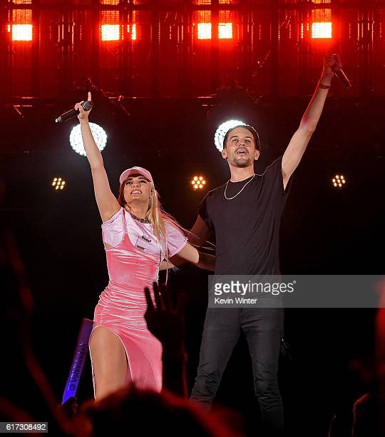 Recording artists Bebe Rexha and GEazy perform onstage during CBS RADIO's fourth annual We Can Survive concert at the Hollywood Bowl on October 22...
