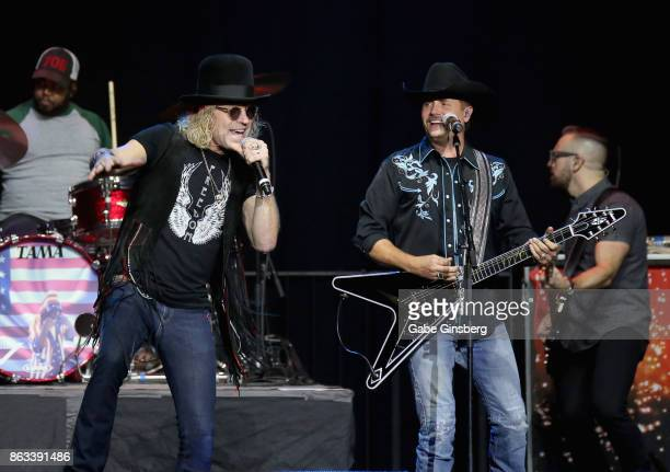 Recording artists Big Kenny Alphin and John Rich of Big Rich perform during 'Vegas Strong A Night of Healing' at the Orleans Arena on October 19 2017...