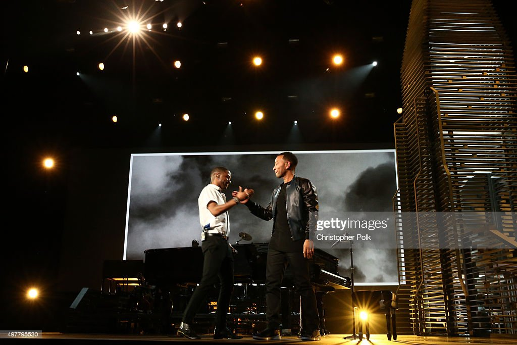 Recording artists Big Sean (L) and John Legend perform onstage at A+E Networks 'Shining A Light' concert at The Shrine Auditorium on November 18, 2015 in Los Angeles, California.