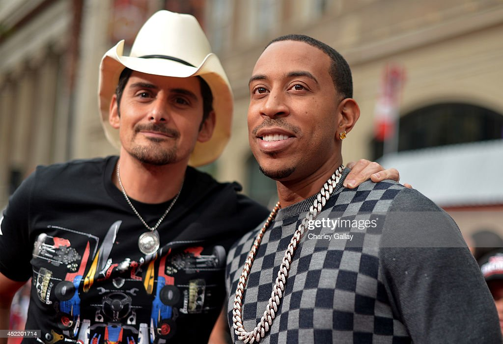 Recording artists <a gi-track='captionPersonalityLinkClicked' href=/galleries/search?phrase=Brad+Paisley&family=editorial&specificpeople=206616 ng-click='$event.stopPropagation()'>Brad Paisley</a> (L) and Chris '<a gi-track='captionPersonalityLinkClicked' href=/galleries/search?phrase=Ludacris&family=editorial&specificpeople=203034 ng-click='$event.stopPropagation()'>Ludacris</a>' Bridges attend World Premiere Of Disney's 'Planes: Fire & Rescue' at the El Capitan Theatre on July 15, 2014 in Hollywood, California.