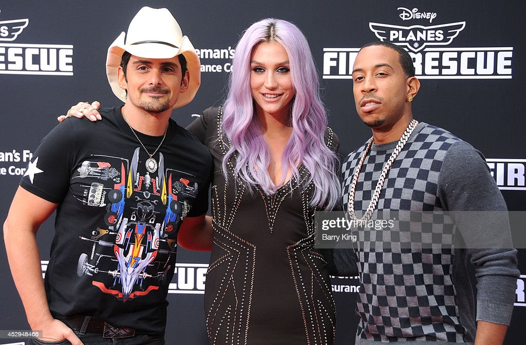 Recording artists Brad Paisley, Kesha and Ludacris attend the premiere of 'Planes: Fire & Rescue' on July 15, 2014 at the El Capitan Theatre in Hollywood, California.