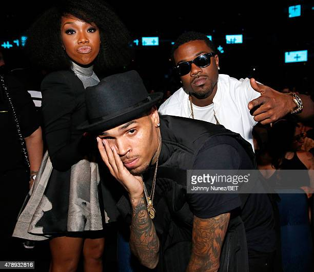 Recording artists Brandy Norwood Chris Brown and Ray J attend the 2015 BET Awards at the Microsoft Theater on June 28 2015 in Los Angeles California