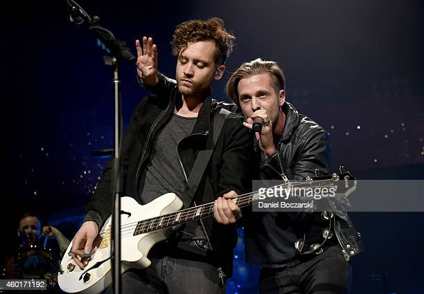 Recording artists Brent Kutzle and Ryan Tedder of music group OneRepublic perform onstage at 1013 KDWB's Jingle Ball 2014 presented by Sky Zone...