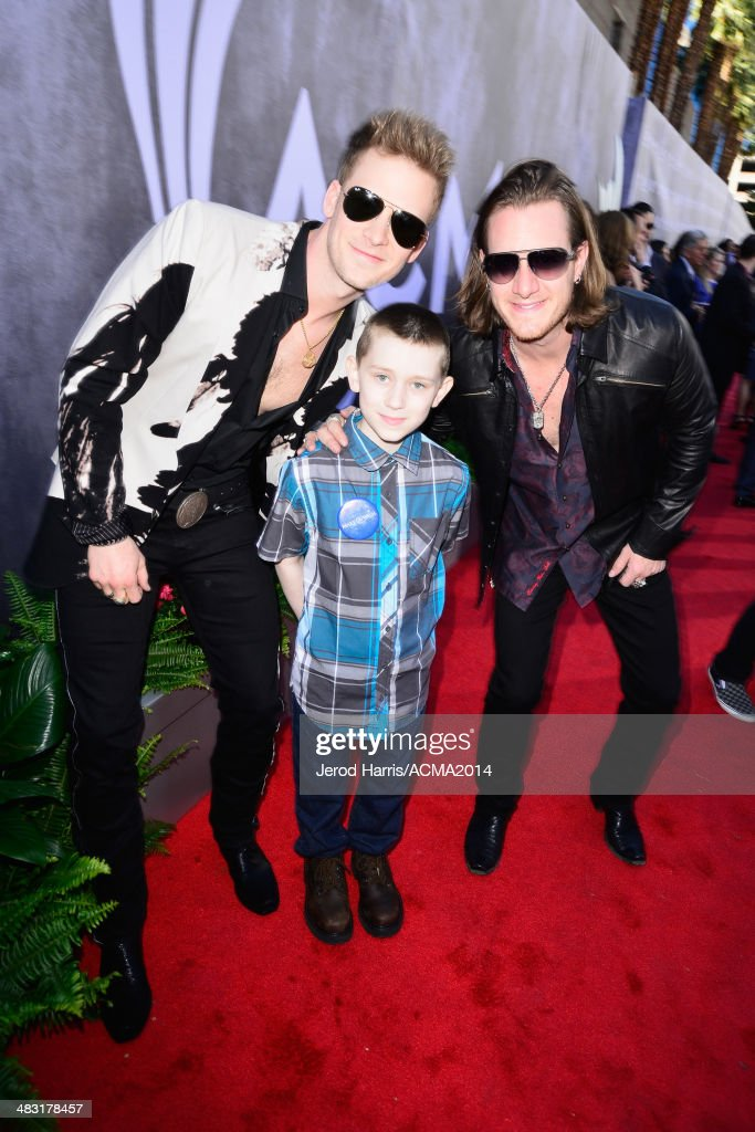 Recording artists Brian Kelley (L) and <a gi-track='captionPersonalityLinkClicked' href=/galleries/search?phrase=Tyler+Hubbard&family=editorial&specificpeople=9453787 ng-click='$event.stopPropagation()'>Tyler Hubbard</a> of Florida Georgia Line with Make-A-Wish Foundation recipient Matthew attend the 49th Annual Academy of Country Music Awards at the MGM Grand Garden Arena on April 6, 2014 in Las Vegas, Nevada.