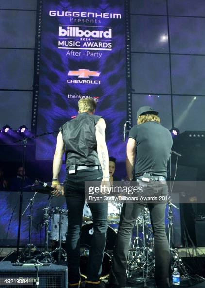 Recording artists Brian Kelley and Tyler Hubbard of Florida Georgia Line perform onstage during the Official AfterParty for the 2014 Billboard Music...