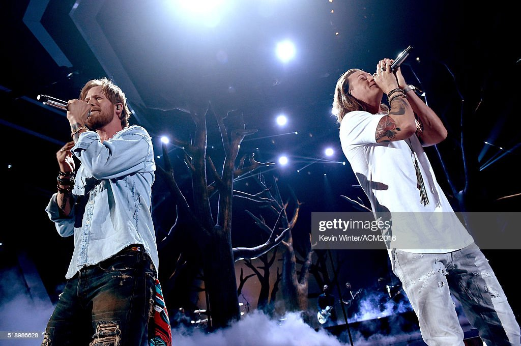 Recording artists Brian Kelley (L) and Tyler Hubbard of Florida Georgia Line perform onstage during the 51st Academy of Country Music Awards at MGM Grand Garden Arena on April 3, 2016 in Las Vegas, Nevada.