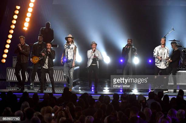 Recording artists Brian Kelley and Tyler Hubbard of music group Florida Georgia Line perform with Nick Carter AJ McLean Brian Littrell and Kevin...