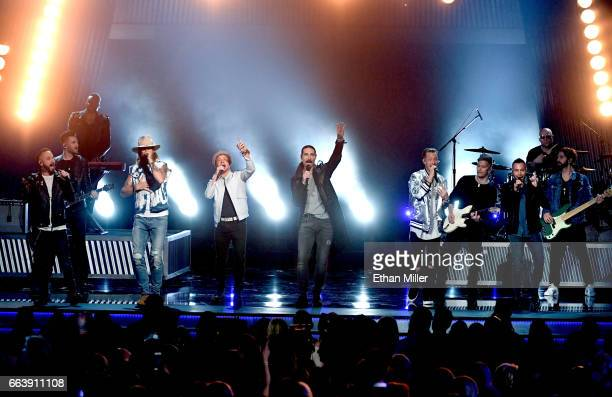 Recording artists Brian Kelley and Tyler Hubbard of music group Florida Georgia Line perform with AJ McLean Brian Littrell and Howie Dorough of music...