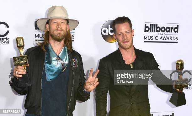 Recording artists Brian Kelley and Tyler Hubbard of music group Florida Georgia Line pose with the 'Top Country Song' award at the 2017 Billboard...