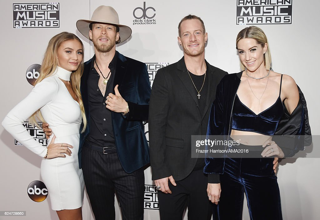 Recording artists Brian Kelley (2nd from L) and Tyler Hubbard (2nd from R) of musical group Florida Georgia Line attend the 2016 American Music Awards at Microsoft Theater on November 20, 2016 in Los Angeles, California.