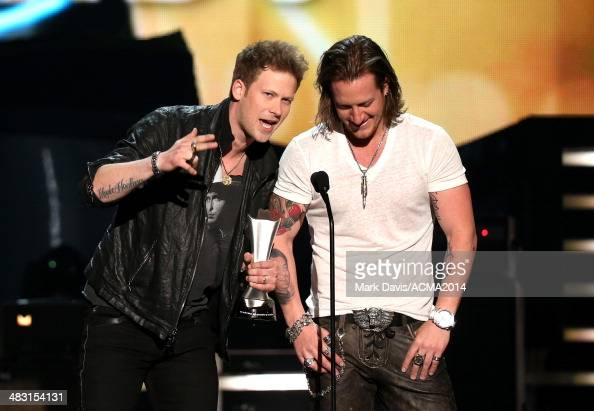 Recording artists Brian Kelley and Tyler Hubbard of the music group Florida Georgia Line accept the award for Vocal Duo Of The Year onstage at the...