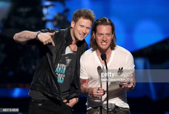 Recording artists Brian Kelley and Tyler Hubbard of the music group Florida Georgia Line speak onstage at the ACM Fan Jam during the 49th Annual...