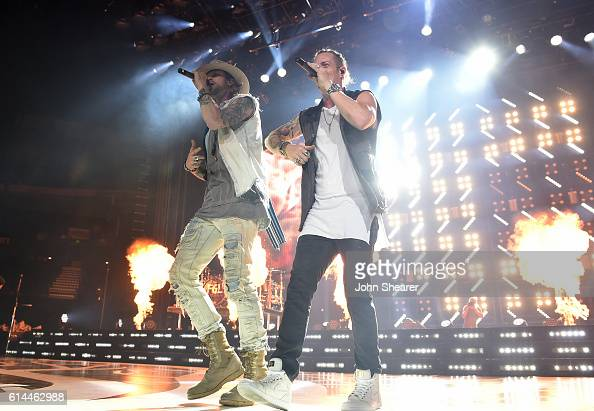 Recording artists Brian Kelley left and Tyler Hubbard of Florida Georgia Line perform on the 'Dig Your Roots' tour at Bridgestone Arena on October 13...