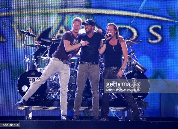 Recording artists Brian Kelley Luke Bryan and Tyler Hubbard of the music group Florida Georgia Line perform onstage at the ACM Fan Jam during the...