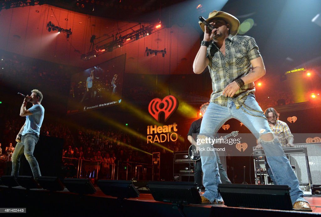 Recording artists Brian Kelley of Florida Georgia Line (L) and <a gi-track='captionPersonalityLinkClicked' href=/galleries/search?phrase=Jason+Aldean&family=editorial&specificpeople=619221 ng-click='$event.stopPropagation()'>Jason Aldean</a> perform onstage during iHeartRadio Country Festival in Austin at the Frank Erwin Center on March 29, 2014 in Austin, Texas.