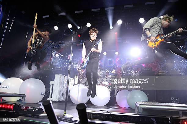 Recording artists Calum Hood Luke Hemmings Ashton Irwin and Michael Clifford of 5 Seconds of Summer perform onstage during Pandora Summer Crush at LA...