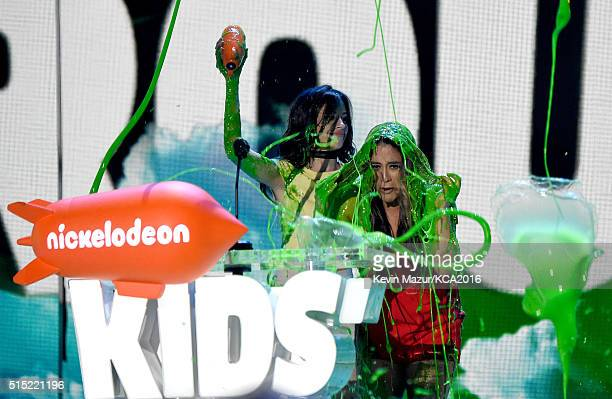 Recording artists Camila Cabello and Ally Brooke of music group Fifth Harmony get slimed while accepting the Favorite Music Group award onstage...