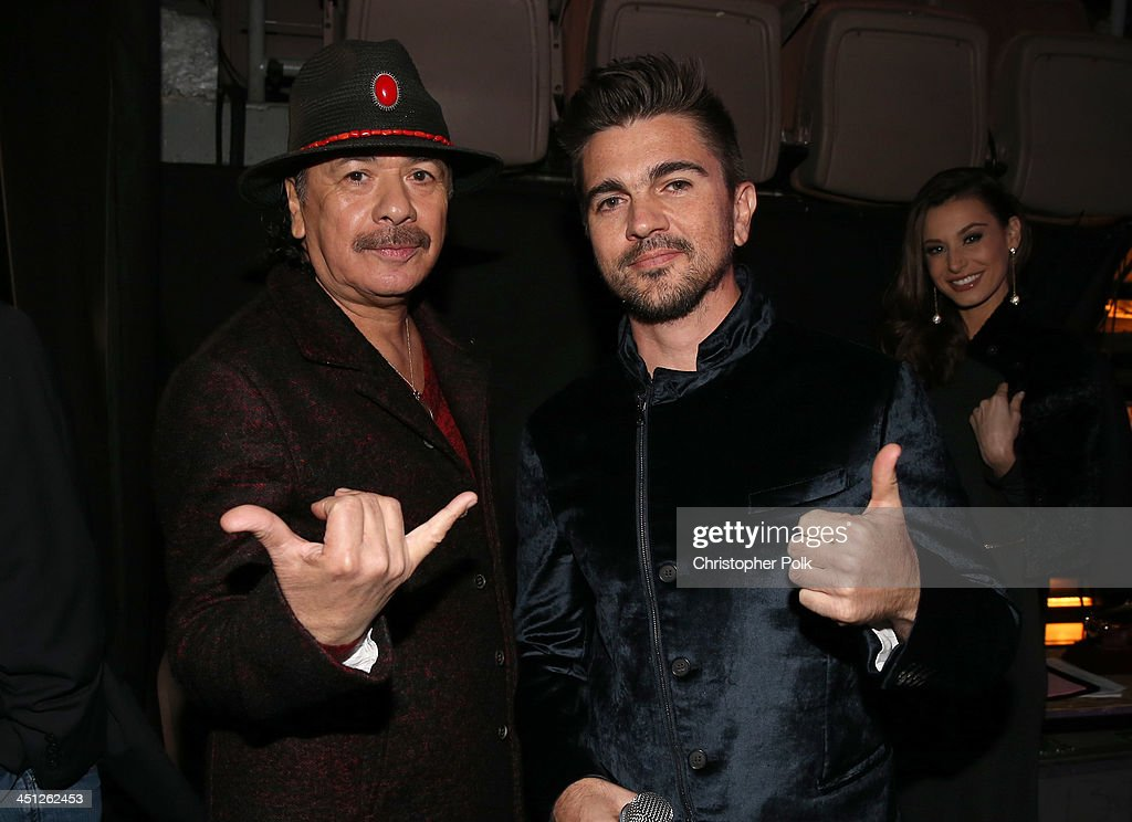 Recording artists Carlos Santana and <a gi-track='captionPersonalityLinkClicked' href=/galleries/search?phrase=Juanes&family=editorial&specificpeople=202467 ng-click='$event.stopPropagation()'>Juanes</a> pose backstage during the 14th Annual Latin GRAMMY Awards held at the Mandalay Bay Events Center on November 21, 2013 in Las Vegas, Nevada.