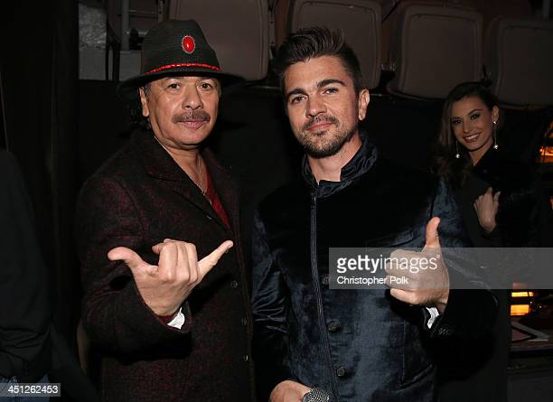 Recording artists Carlos Santana and Juanes pose backstage during the 14th Annual Latin GRAMMY Awards held at the Mandalay Bay Events Center on...