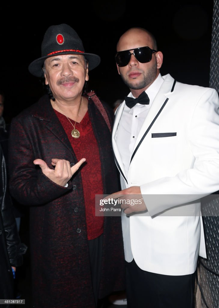Recording artists Carlos Santana (L) and Sessino attend The 14th Annual Latin GRAMMY Awards at the Mandalay Bay Events Center on November 21, 2013 in Las Vegas, Nevada.