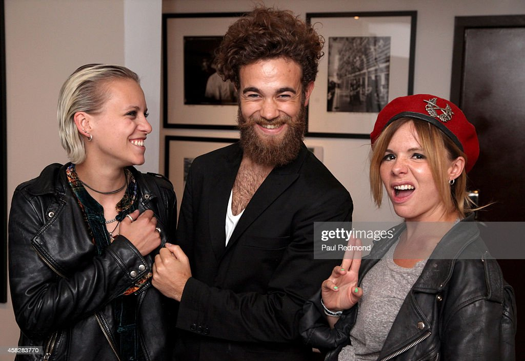 Recording artists Carmen Vandenberg, Filippo Cimatti and Rosie Bones of the band Bones attend the reception celebrating the book launch for 'Echo Home' by Jamie Hince of The Kills at Morrison Hotel Gallery on November 1, 2014 in West Hollywood, California.