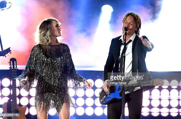Recording artists Carrie Underwood and Keith Urban perform onstage during the 52nd Academy of Country Music Awards at TMobile Arena on April 2 2017...