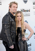 Recording artist's Chad Kroeger and Avril Lavigne arrive at the 2013 Billboard Music Awards at MGM Grand Garden Arena on May 19 2013 in Las Vegas...