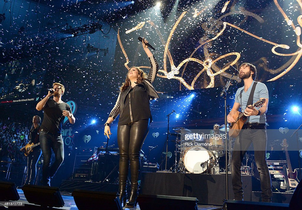Recording artists Charles Kelley, Hillary Scott and Dave Haywood of Lady Antebellum perform onstage during iHeartRadio Country Festival in Austin at the Frank Erwin Center on March 29, 2014 in Austin, Texas.