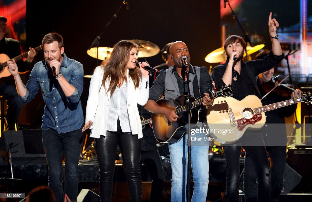 Recording artists <a gi-track='captionPersonalityLinkClicked' href=/galleries/search?phrase=Charles+Kelley&family=editorial&specificpeople=3935435 ng-click='$event.stopPropagation()'>Charles Kelley</a> (L), Hillary Scott (2nd L) and <a gi-track='captionPersonalityLinkClicked' href=/galleries/search?phrase=Dave+Haywood&family=editorial&specificpeople=4620526 ng-click='$event.stopPropagation()'>Dave Haywood</a> (R) of Lady Antebellum perform onstage with recording artist <a gi-track='captionPersonalityLinkClicked' href=/galleries/search?phrase=Darius+Rucker&family=editorial&specificpeople=215161 ng-click='$event.stopPropagation()'>Darius Rucker</a> (2nd R) duringg the 49th Annual Academy of Country Music Awards at the MGM Grand Garden Arena on April 6, 2014 in Las Vegas, Nevada.