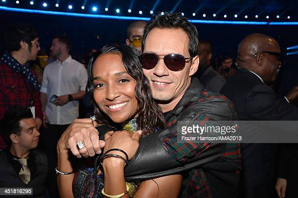 Recording artists Chilli and singer Marc Anthony attend the 2013 American Music Awards at Nokia Theatre LA Live on November 24 2013 in Los Angeles...