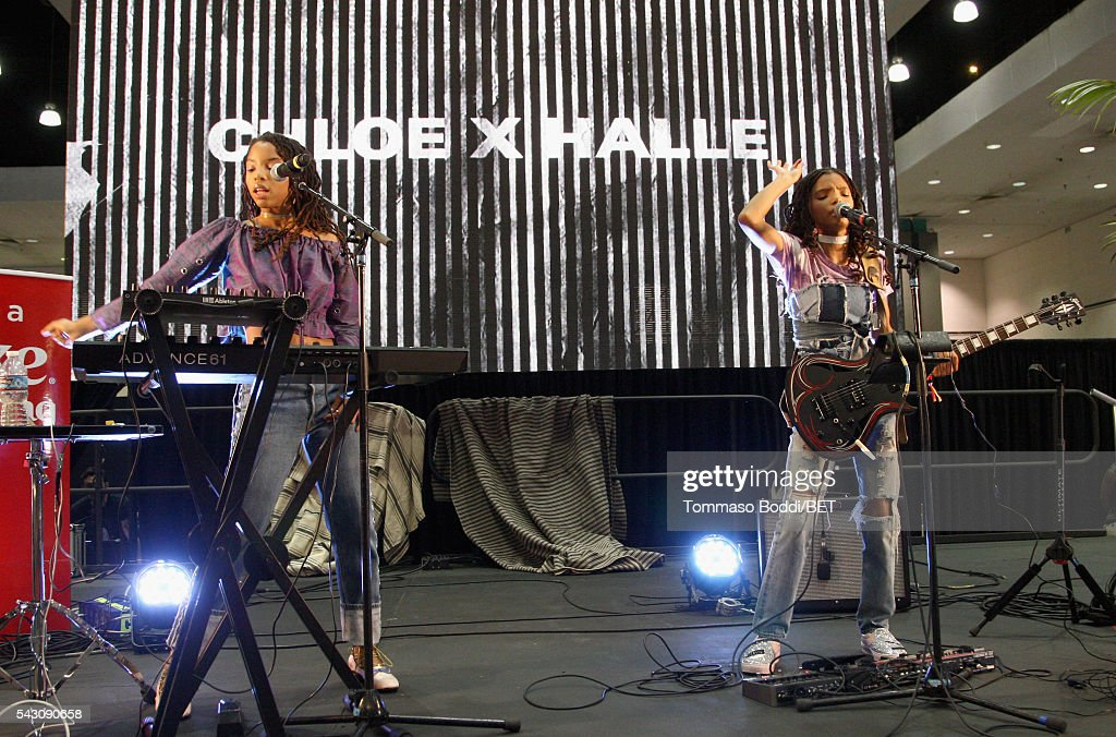 Recording artists Chloe Bailey (L) and Halle Bailey of Chloe x Halle perform onstage at the Coke music studio during the 2016 BET Experience on June 25, 2016 in Los Angeles, California.