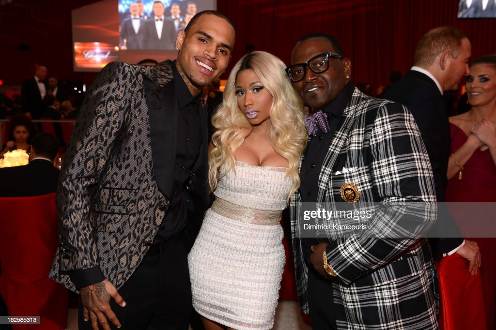 Recording Artists Chris Brown and Nicki Minaj and tv personality Randy Jackson attend the 21st Annual Elton John AIDS Foundation Academy Awards Viewing Party at West Hollywood Park on February 24, 2013 in West Hollywood, California.