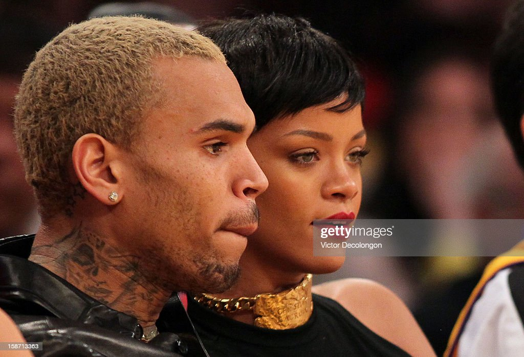 Recording artists Chris Brown and Rihanna attend the NBA game between the New York Knicks and the Los Angeles Lakers at Staples Center on December 25, 2012 in Los Angeles, California. The Lakers defeated the Knicks 100-94.