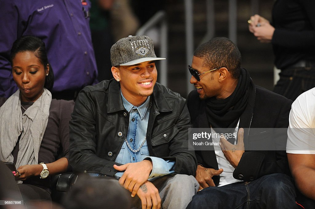 Recording artists Chris Brown and Usher attend a game between the Boston Celtics and the Los Angeles Lakers at Staples Center on February 18, 2010 in Los Angeles, California.