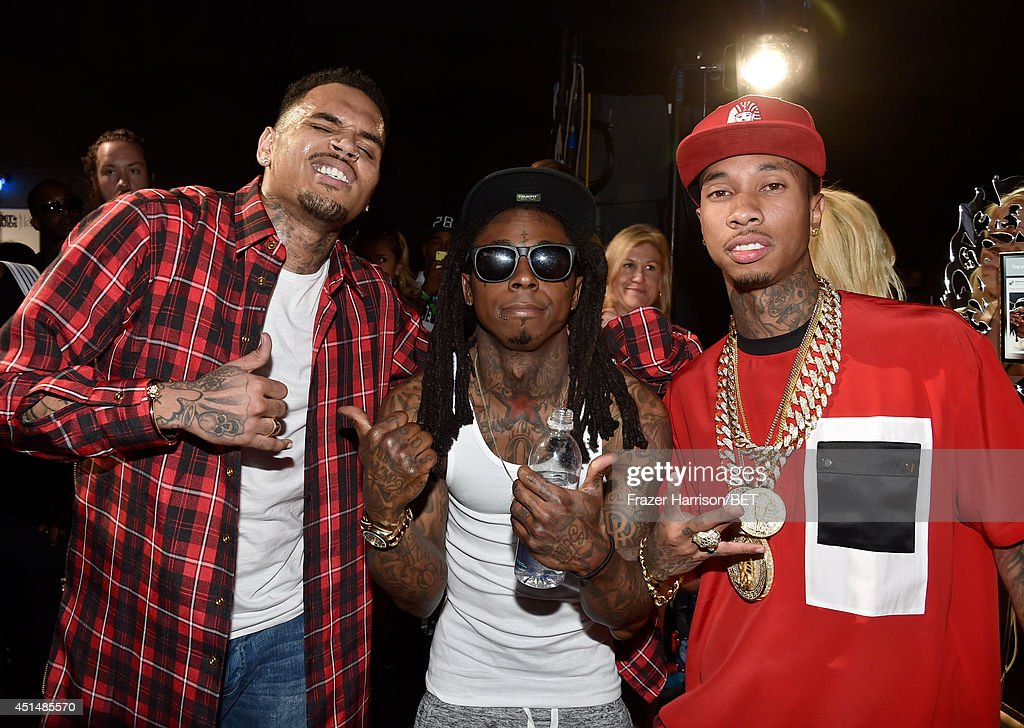 Recording artists <a gi-track='captionPersonalityLinkClicked' href=/galleries/search?phrase=Chris+Brown+-+Singer&family=editorial&specificpeople=4452016 ng-click='$event.stopPropagation()'>Chris Brown</a>, Lil Wayne, and <a gi-track='captionPersonalityLinkClicked' href=/galleries/search?phrase=Tyga&family=editorial&specificpeople=4489457 ng-click='$event.stopPropagation()'>Tyga</a> attend the BET AWARDS '14 at Nokia Theatre L.A. LIVE on June 29, 2014 in Los Angeles, California.