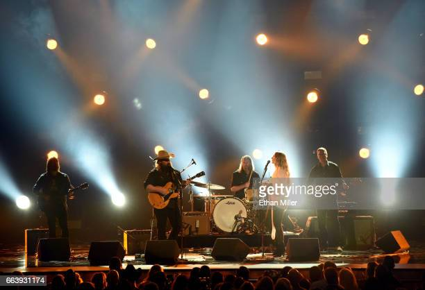 Recording artists Chris Stapleton and Morgane Stapleton perform onstage during the 52nd Academy of Country Music Awards at TMobile Arena on April 2...