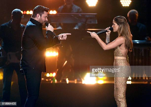 Recording artists Chris Young and Cassadee Pope perform onstage during the 51st Academy of Country Music Awards at MGM Grand Garden Arena on April 3...